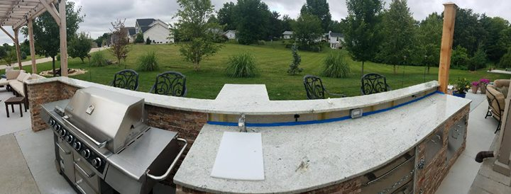 Beautiful Colonial White outdoor kitchen installed toda...