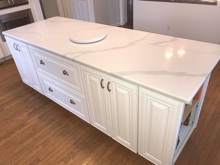 Gorgeous Aurea Stone quartz kitchen island & master...